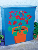 Convert an old kitchen cupboard into secure storage for garden bits and pieces