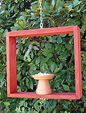 Make a mini bird feeder and paint with Resene totem pole red