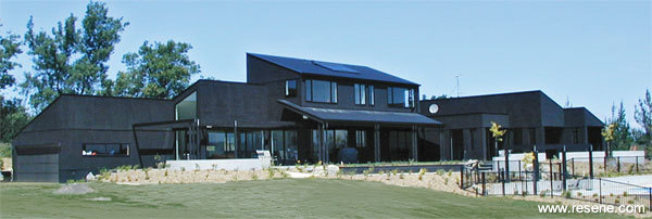 Exterior timber finished in Resene Waterborne Woodsman CoolColour™ tinted to Resene Black