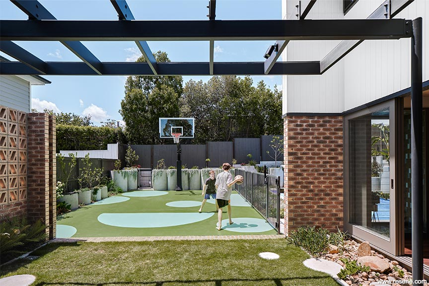Breezebrick Courtyard House - a colourful play area